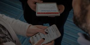 woman using VolunteerHub Simple & Streamlined volunteer management software on phone